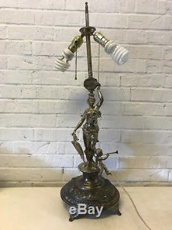 Antique Silver Plated or Spelter Figural Lamp Woman with Shield Child Playing Horn