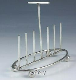 Christopher Dresser style silver plate toast or letter rack, English circa 1890