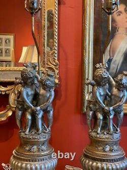 Pair of Early Century Figurative Silver Plated Porcelain Lamps