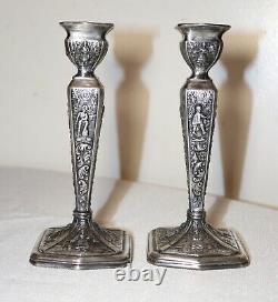 Pair of antique ornate Jennings Brothers silver-plated candlesticks holders