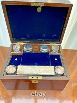 Victorian mahogany vanity box with silver plate topped bottles/jars