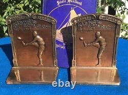 Vintage silver-plated football bookends, leather helmets, circa 1920s
